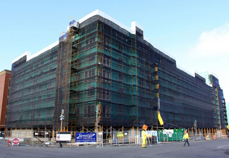 Building with High density knitted polyethylene debris netting.