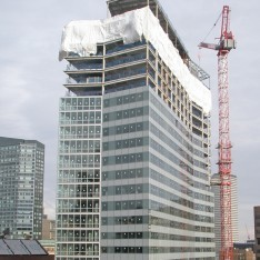 Construction Tarp on Hi-rise building with crane